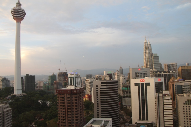 """Full """"view to die for"""" of KL Tower (including the base) and Petronas Towers from the living room."""