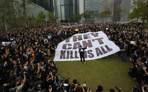 'They can't kill us all': Thousands protest chopper attack on Ming Pao editor Kevin Lau