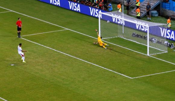Costa Rica's Michael Umana scores during a penalty shootout against Greece in their 2014 World Cup round of 16 game at the Pernambuco arena