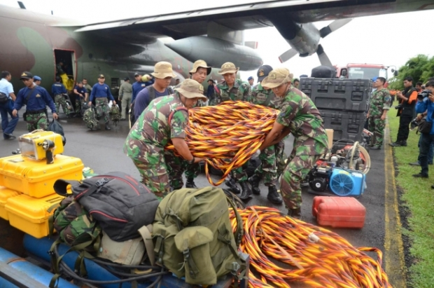 7. Indonesian marines unloading their diving equipment & orange hoses