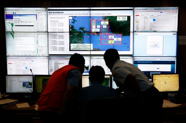 Authorities monitor progress in search for AirAsia Flight QZ8501 in Mission Control Center inside National Search and Rescue Agency in Jakarta