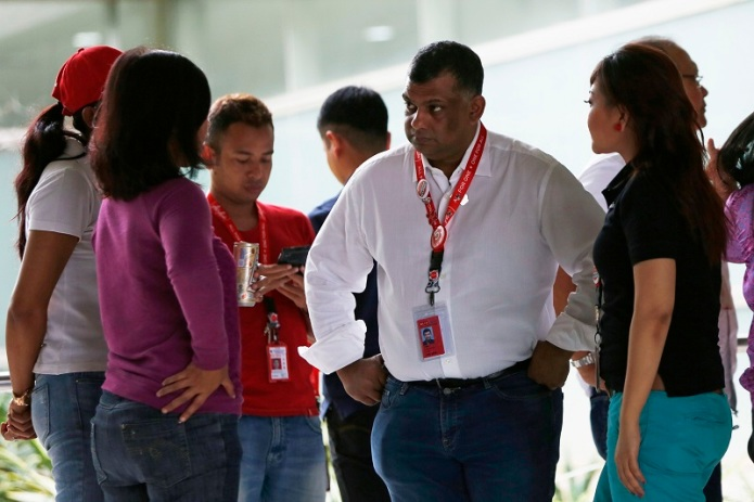 AirAsia CEO Fernandes talks with his staff at Surabaya's Juanda International Airport