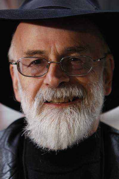 File photograph of British author Pratchett posing after delivering a petition on the behalf of the Alzheimer's Research Trust to 10 Downing Street in London