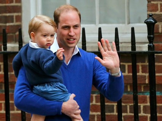 Britain's Prince William returns with his son George to the Lindo Wing of St Mary's Hospital, after the birth of his daughter in London