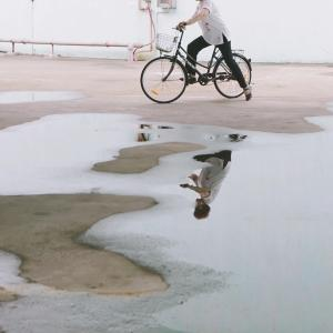 --ONE TIME USE ONLY--  --NO ARCHIVES--  This handout image shows an instagram image of a bicyclist reflected in a puddle  taken by Kelvin Tirta.  07APR15   [18JUN2015 LEAD FEATURE 2 48HRs ]