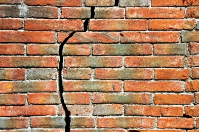 Old cracked brick wall spring home repairs.jpg