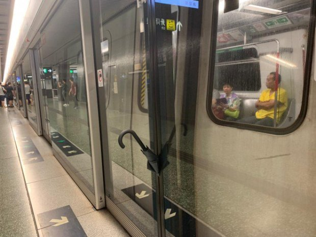 13. Discarded Umbrellas prevent MTR platform doors from closing in Diamond Hill Station by Martin Choi