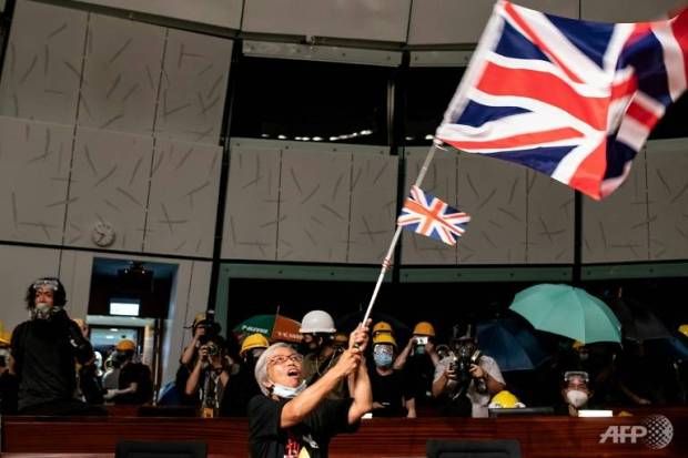 16. Alexandra Wong injured here seen waving the-British Flag-in-the-parliament-chamber