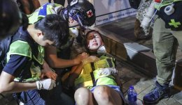 A woman injured during a clash in Western district. Photo Edmond So