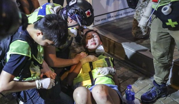 A woman injured during a clash in Western district. Photo Edmond So.jpg