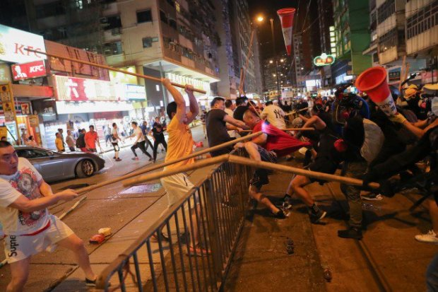 Pro-China White Triad Mob is back with Poles battles Protesters as chaos reigns -2