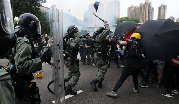 Protesters and police clash in a pattern that has increasingly been violent. Photo Sam Tsang.jpg