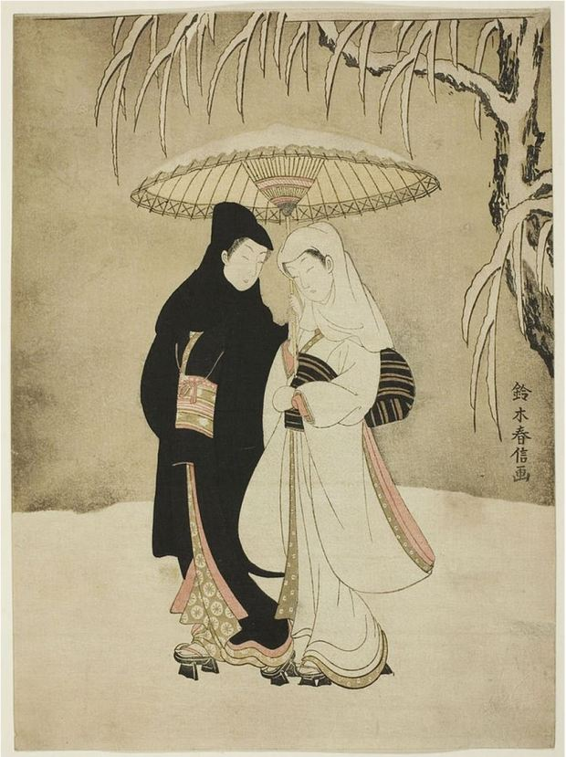 Two Lovers under umbrella in snow