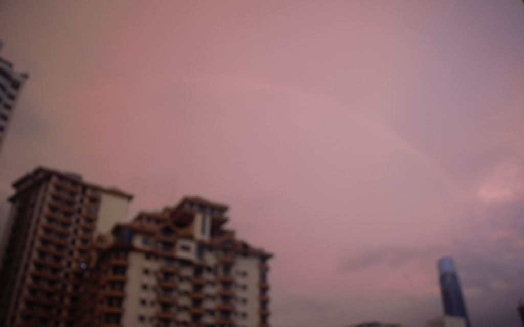 This image has an empty alt attribute; its file name is rainbow-sign.jpg